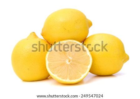 fresh yellow lemons on white background - stock photo