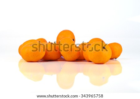 fresh yellow oranges isolated on white - stock photo
