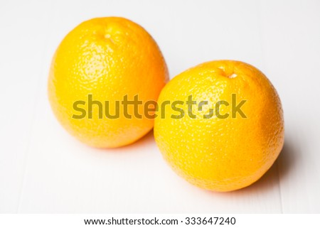 fresh yellow oranges on white background - stock photo