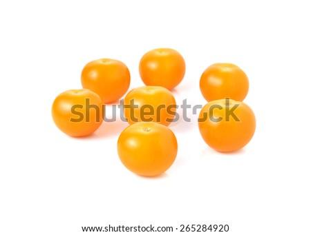fresh yellow plum tomato on white background - stock photo