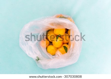Fresh Yellow Shiro Plums  in Plastic Bag just From Farmer's Market - stock photo