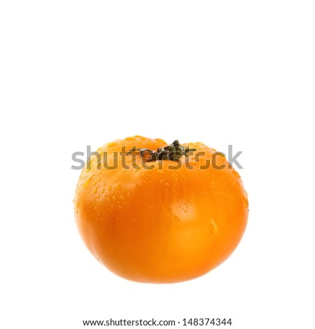 Fresh yellow tomato - isolated on white background