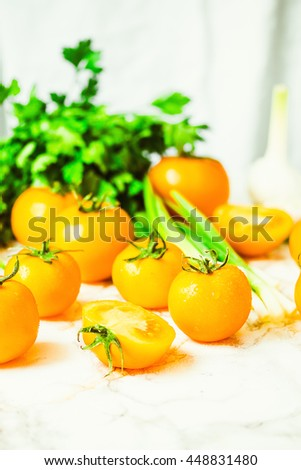 fresh yellow tomatoes, juicy summer vegetables and juicy greens, healthy lifestyle and food concept,selective focus - stock photo