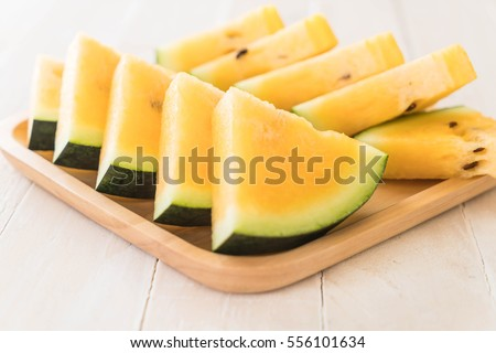 fresh yellow watermelon on wood