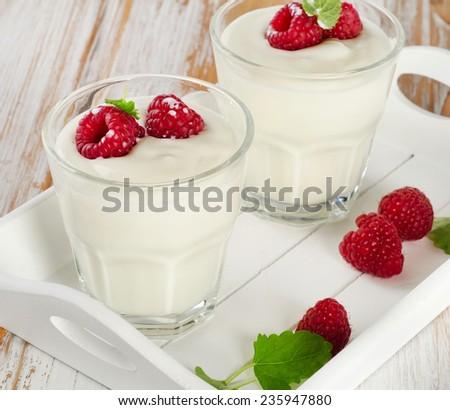 Fresh yogurt with  berries  . Selective focus - stock photo