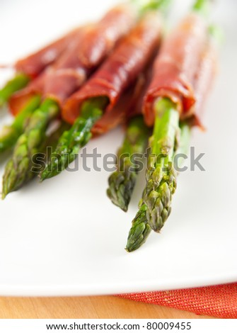 Fresh Young Asparagus Wrapped in Prosciutto Meat and Grilled - stock photo