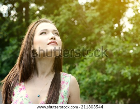 Fresh young beautiful woman. Portrait of girl summer outdoor, image toned. - stock photo