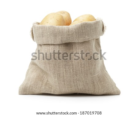 fresh young potato in sack bag, isolated on white - stock photo