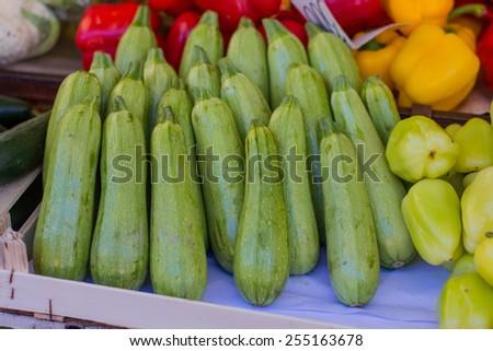Fresh Zucchini on the marketplace. - stock photo