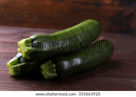 Fresh zucchini on wooden background - stock photo