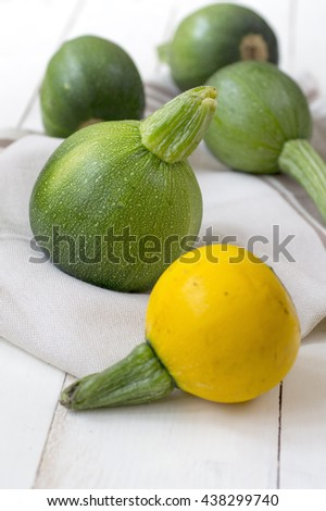 Fresh zucchini  on wooden table, close up - stock photo