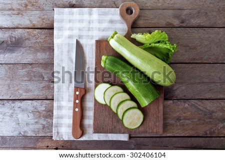 Fresh zucchini with squash on cutting board - stock photo
