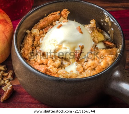 Freshly baked apple crisp a la mode with a walnut topping. A delicious ...