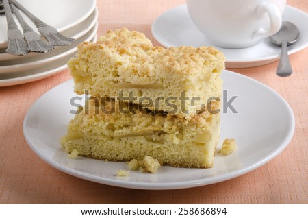 freshly baked apple crumble cake on a plate - stock photo