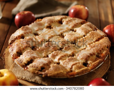 freshly baked apple pie with lattice design shot close up with selective focus - stock photo