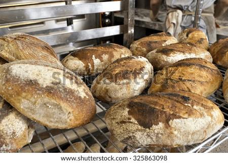 Freshly baked artisanal bread in a bakery. - stock photo