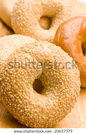 Freshly baked bagels in  a pile - stock photo