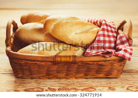 Freshly baked baguette in a basket. Food background   - stock photo