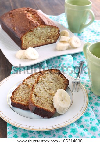 Freshly Baked Banana Bread with fresh bananas - stock photo