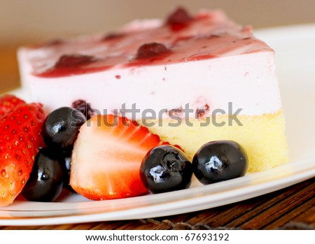 Freshly baked blueberry cheese cake with fresh  blueberries and strawberries on the side