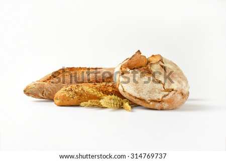 freshly baked bread and baguettes on white background