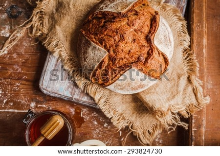 Freshly baked bread in rustic setting with copyspace on blackboard from above. Rustic style. - stock photo