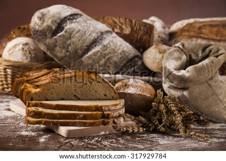 Freshly baked bread on the wooden - stock photo