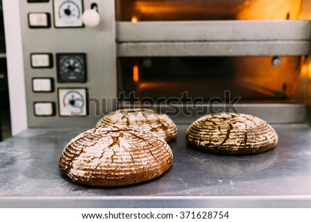 Freshly baked bread outside  the oven - stock photo