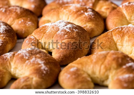 Freshly baked brioche bread rolls made with a slightly sweet pastry with eggs in a close up low angle full frame view - stock photo