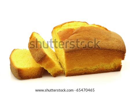 freshly baked cake and some slices on a white background