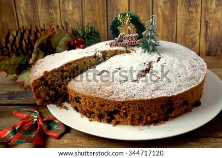 freshly baked Christmas fruit cake on white  plate - stock photo