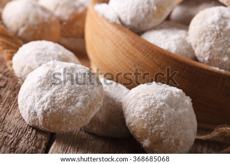 Freshly baked cookies polvoron macro in wooden bowl. horizontal
