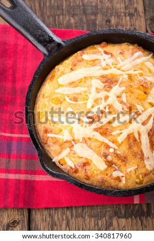 Freshly baked corn bread in cast iron pan. Top view. - stock photo