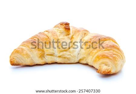 Freshly baked croissant. All on white background - stock photo