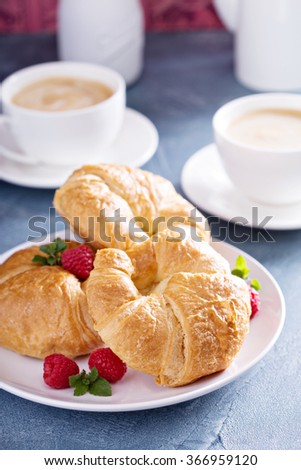 Freshly baked croissants and coffee for breakfast