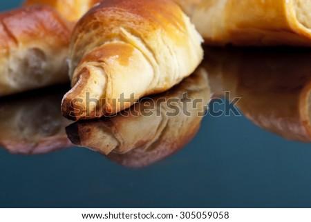 Freshly baked croissants on plate for breakfast - stock photo