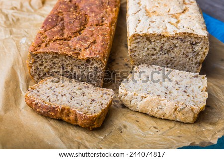 Freshly baked crusty bread on a wooden kitchen table