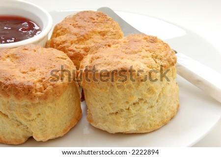 Freshly baked fruit scones with jam, macro - stock photo
