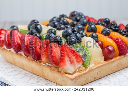 Freshly baked fruit tart with berries and fresh fruit - stock photo