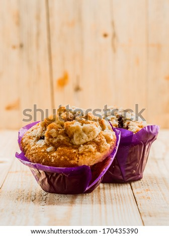 Freshly baked golden muffins for breakfast with nuts , bran and muesli for a healthy start to the day - stock photo