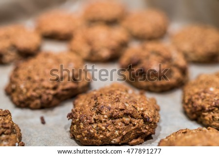 Freshly baked healthy home made banana sweetened oat cookies. Close up with shallow dof.