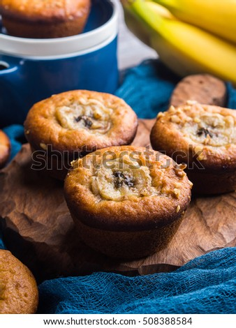 Freshly baked home made spiced banana muffins with walnuts. Vertical image