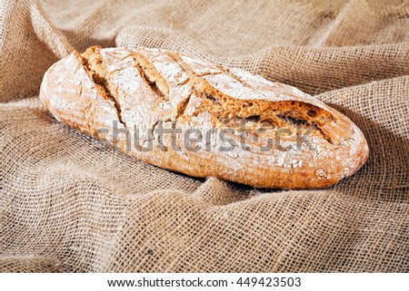 freshly baked homemade bread on a linen cloth