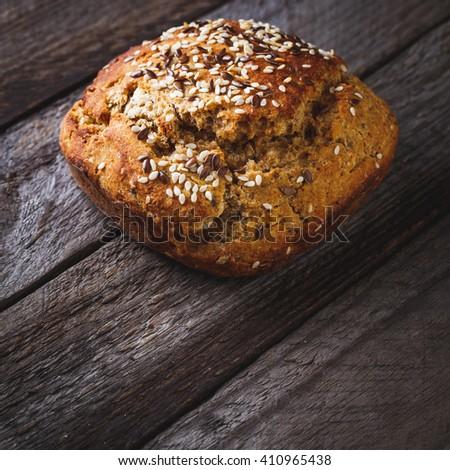 Freshly baked homemade bread on rustic dark wooden background - stock photo