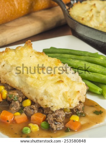 "freshly baked homemade shepherd's pie with beef and vegetables""shepherd's pie"" - stock photo"