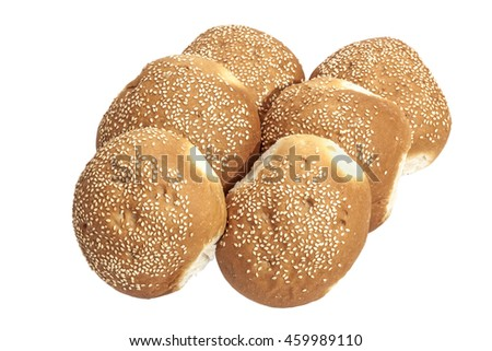 Freshly baked isolated stacked golden hamburger rolls sprinkled with sesame seeds in white