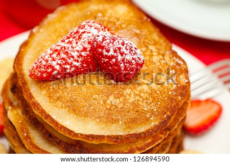 freshly baked pancakes and strawberry - stock photo