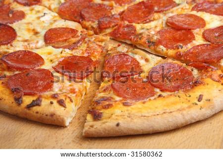 Freshly baked pepperoni pizza - stock photo