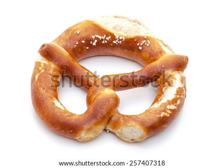 Freshly baked salted lye pretzel. All on white background. - stock photo
