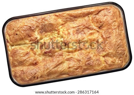 Freshly baked Serbian Traditional Gibanica cheese crumpled pie, in baking Pan, Isolated on White Background. - stock photo